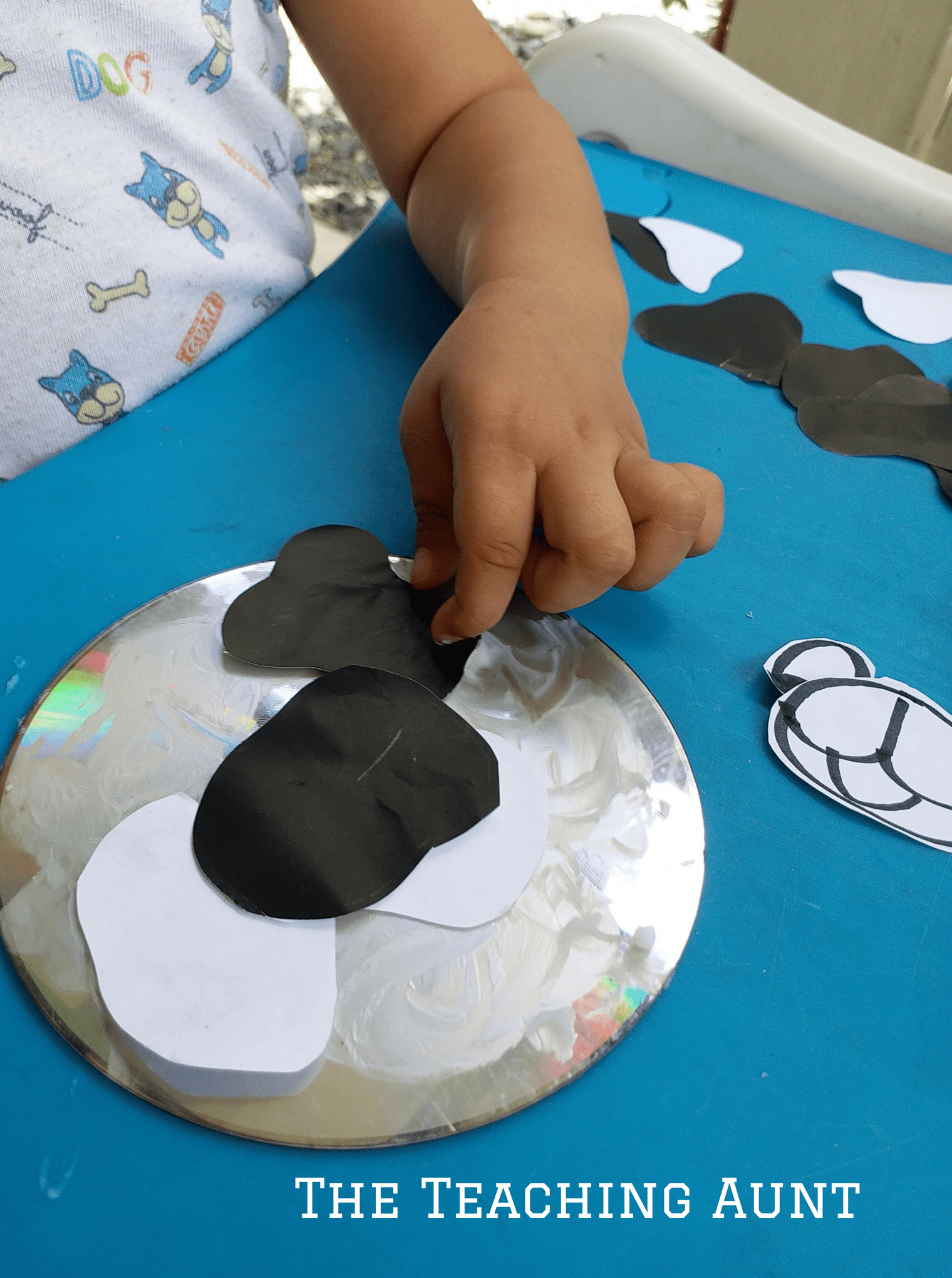 Pasting Papers- CD Cow Art and Craft