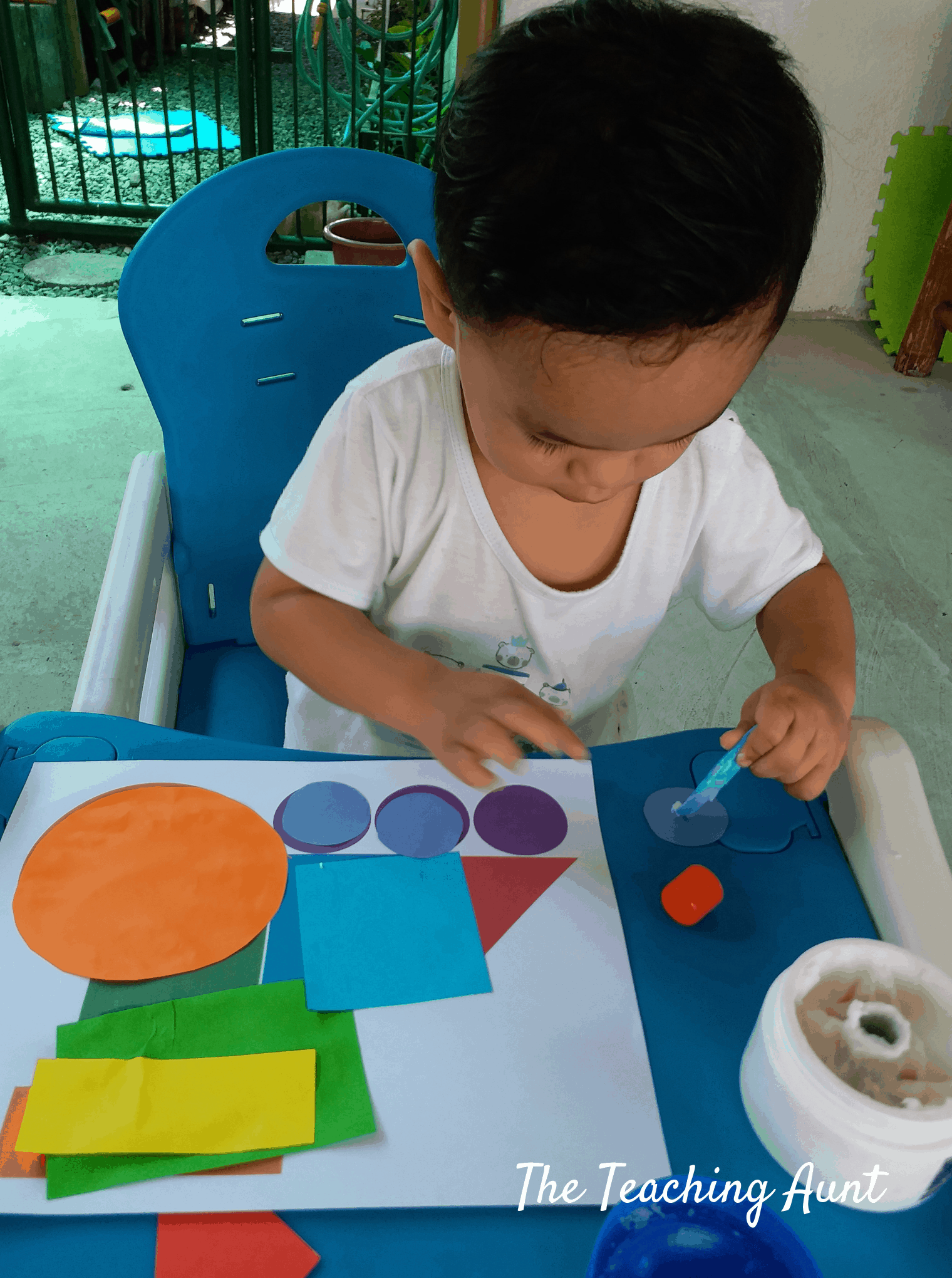 Train shapes Pasting: Toddler Using Glue